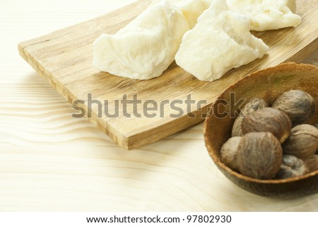 shea butter with shea butter nuts on wooden