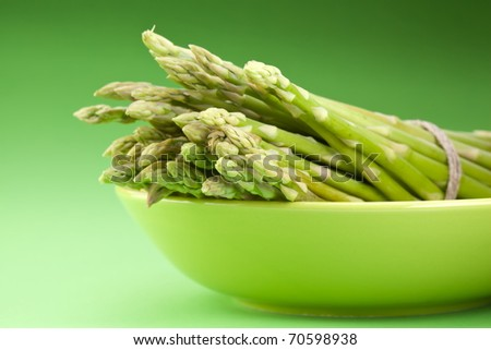 Sheaf of asparagus on a green background.