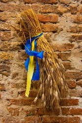 Sheaf of wheat. Sign outside a Tuscan bakery front door in the medieval town of San Gimignano