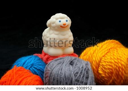 Sheep over balls of yarn