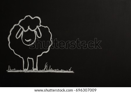Sheep with chalk on Black Board for Eid Mubarek #696307009