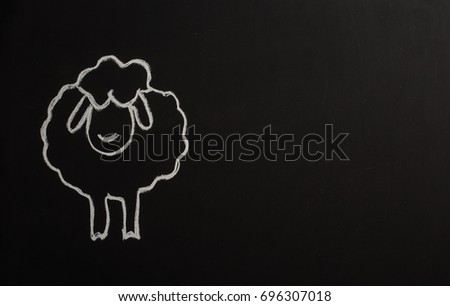 Sheep with chalk on Black Board for Eid Mubarek #696307018