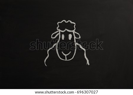 Sheep with chalk on Black Board for Eid Mubarek #696307027