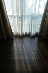 sheer curtain (translucent fabric) and wood laminate floor with balcony from high rise condominium, lonely feeling after staying home all day or all week, living alone in self-isolation