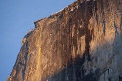 Sheer granite cliff of the face of Half Dome, Yosemite National Park, USA.