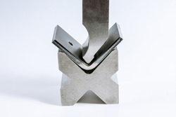 Sheet metal bending tool and equipment isolated on a white background. Bend tools, press brake punch and die.
