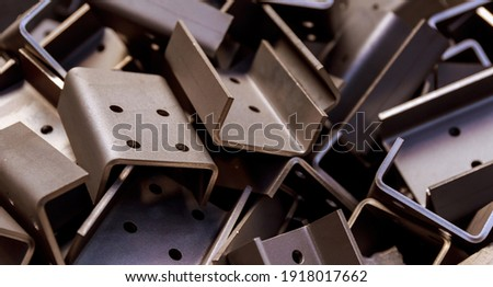 sheet metal product after processing on a bending machine. Precise bending of metal product Stockfoto ©