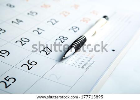 sheet of a calendar and a pen close-up