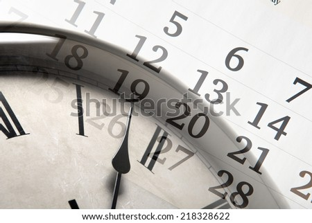 sheet of a calendar with the number of days and clock