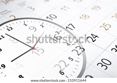 sheet of a calendar with the number of days and clock close-up
