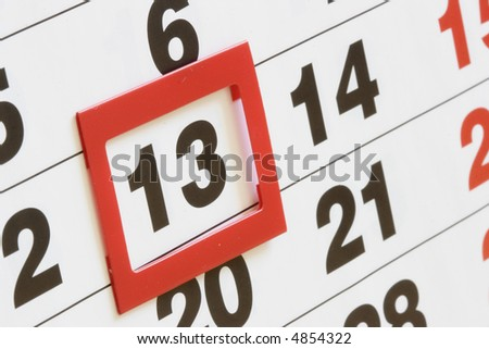 Sheet of calendar with red mark on Friday, 13