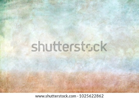 Sheet of paper with blurry watercolor paints, on top of greenish tones, a blue and brown strip appears to the bottom, a gentle watercolor background. #1025622862