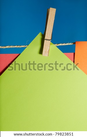 Sheet of paper with space for copy text, hanging from a rope with a clamp