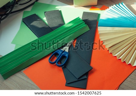 sheets of colored paper, scissors, blanks for origami. blanks for paper fan. Template for design, advertisement or text. #1542007625