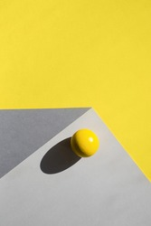 sheets of paper create illusion of three-dimensional cube. ball with hard shadow. geometric background in trending colors of year 2021.