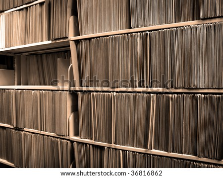 Shelf full of folders and files in an office - stock photo