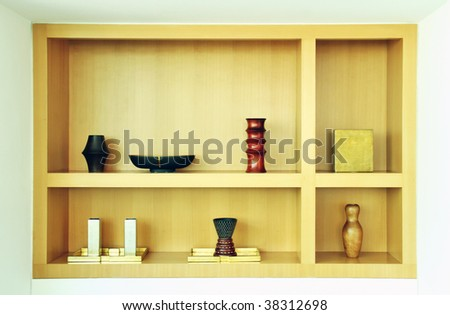 Shelf on wall with vases and decoration items