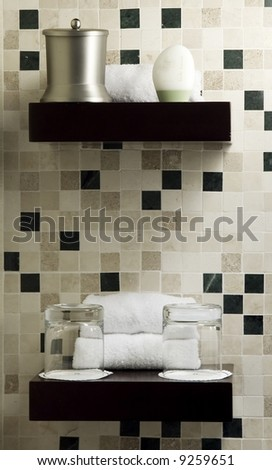 Shelf with beauty products in a spa or guest room. Ambient light