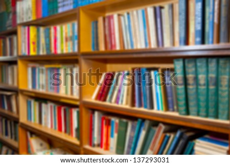 shelf with books in the library background. the image was blurred for use as a background.