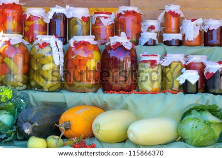 Shelf with canned fruit and vegetable