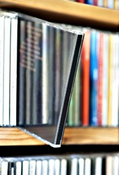 Shelf with CDs with one sticking out