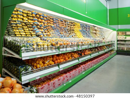 Shelf with citrus fruits, TM's removed, price tags left in place and contain no copyright.