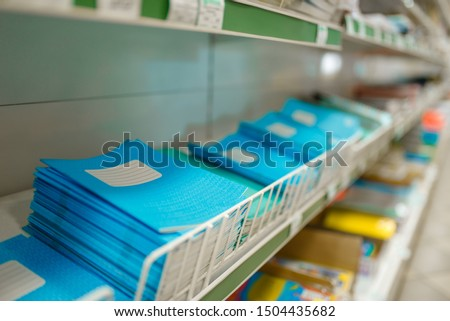 Shelf with notebooks in stationery store, nobody #1504435682
