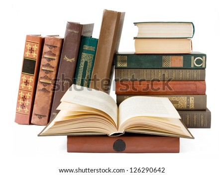 Shelf with old antique book isolated on white background