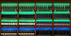 shelf with rows of wine bottles
