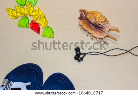 Shell, headphones, stones, beach slippers to relax on the beach by the sea Сток-фото ©