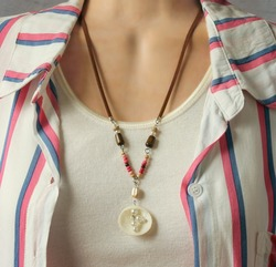 shell necklace on a mannequin, closeup portrait of a necklace on female