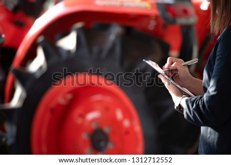 Shell sells women, handles the clipboard and checks the tractor every day before selling.