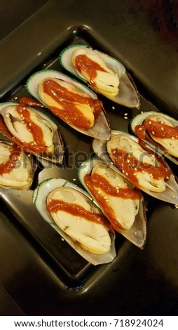 Shell, shellfish with sauce in the plate, prepared ingredient., prepared ingredient. #718924024
