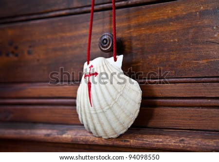 Shell with red cross, souvenir of the camino de Santiago de Compostela, Galicia, Spain.