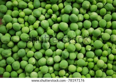 Shelled fresh ripe sweet green peas background, horizontal
