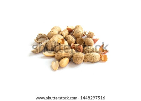 shelled peanuts and peeled peanuts. peanuts on a white background