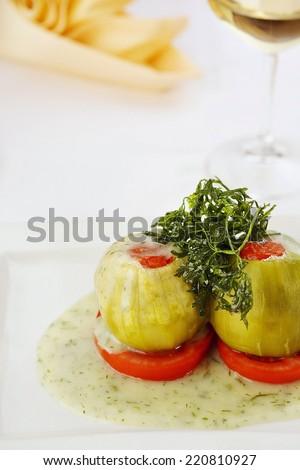 Shelled stuffed zucchini. Stuffed vegetable. Restaurant cuisine. Vegetarian food/Stuffed zucchini