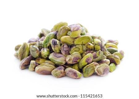 shelled whole pistachio nuts isolated on a white background,