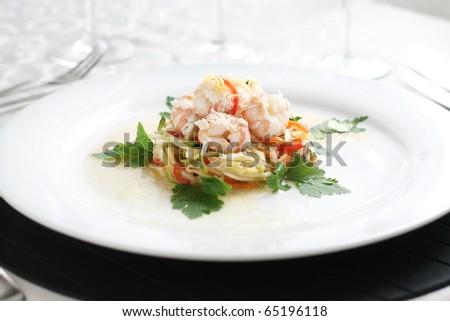 Shellfish specialty on white plate in restaurant