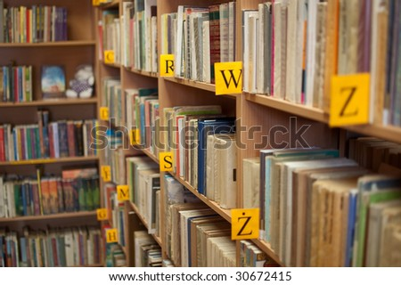 Shelves of books in library (shallow focus)