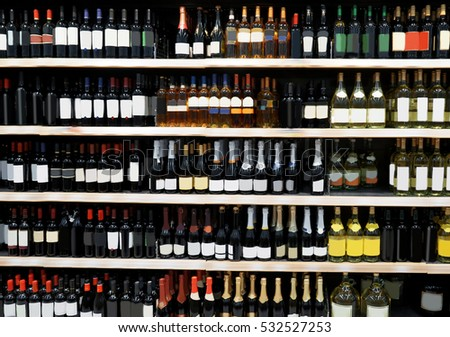 Shelves with alcohol bottles in supermarket