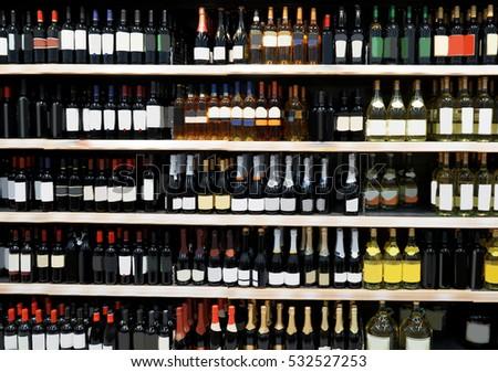 Shelves with alcohol bottles in supermarket #532527253