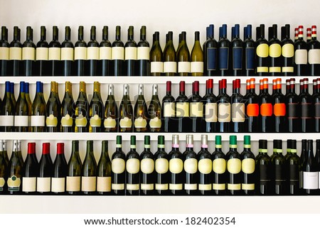 Shelves with big wine collection #182402354