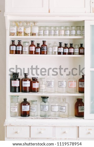 Shelves with bottles of drugs in ancient drugstore