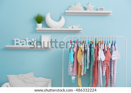 Shelves with hanger in modern baby room #486332224