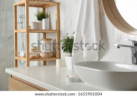 Shelving unit with toiletries in bathroom interior Photo stock ©