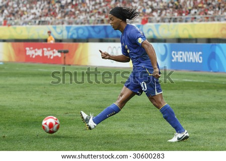 SHENYANG, CHINA - AUGUST 10:  Ronaldinho of Brazil passes the ball during a match against New Zealand at the Beijing Olympic Games soccer tournament August 10, 2008 in Shenyang, China.