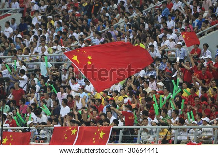 SHENYANG, CHINA - AUGUST 10:  Stadium crowd cheers on China during a match between China and Belgium at the Beijing Olympic Games soccer tournament August 10, 2008 in Shenyang, China.