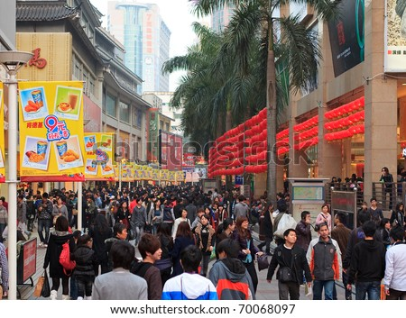 SHENZHEN, CHINA-JAN 26: Shoppers and visitors crowd the famous Dongmen Pedestrian Street on Jan 26, 2011 in Shenzhen, China, ahead of the upcoming Chinese New Year, the year of the rabbit. - stock photo