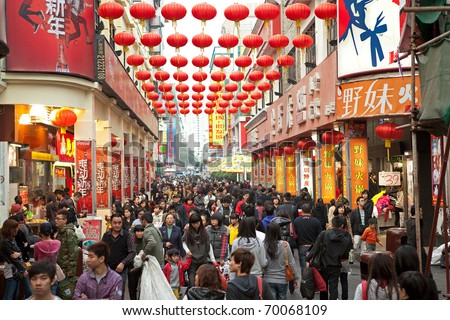 SHENZHEN, CHINA-JAN 27: Shoppers and visitors crowd the famous Dongmen Pedestrian Street on Jan 27, 2011 in Shenzhen, China, ahead of the upcoming Chinese New Year, the year of the rabbit.
